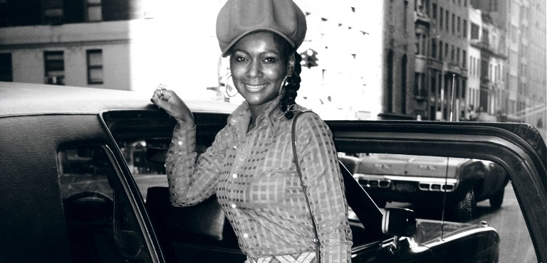 Sylvia Robinson poses next to a car in the 70s